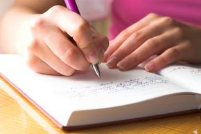 Girl writing in book