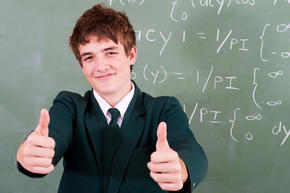student giving a thumbs up at the math board