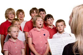 Students singing with a teacher