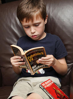 boy reading Farenheit 451