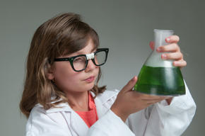 Girl holding flask in science laboratory