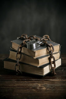 stack of books wrapped in a chain