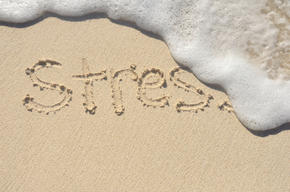 'Stress' written in the sand