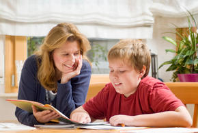 Mother and son reading (homeschooling)