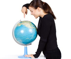 Girl pointing to a globe