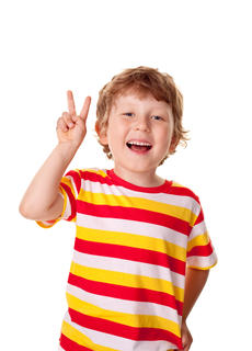 Young boy holding up a peace sign